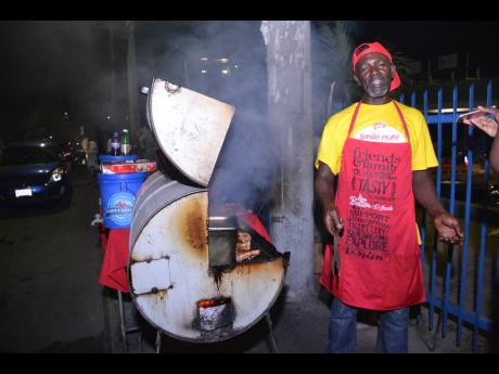 Rueben Hickinson, a pan chicken vendor along Red Hills Road in Kingston.