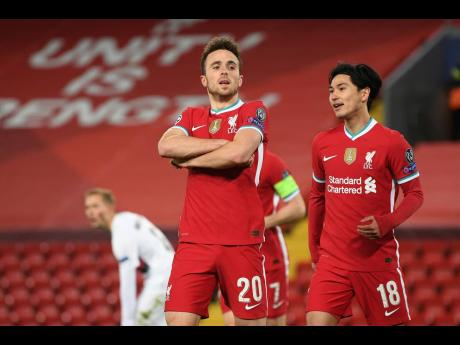 Liverpool's Diogo Jota, 20, celebrates scoring his side's first goal.