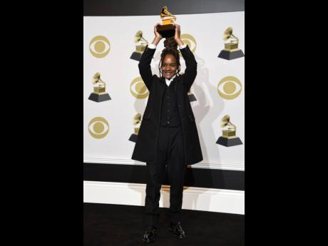 Koffee poses with the award for best reggae album.