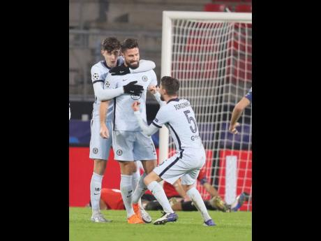 Chelsea's Olivier Giroud (centre) celebrates with his teammates after scoring his side's second goal during the Champions League Group E match against Rennes at the Roazhon Park stadium in Rennes, France, yesterday.