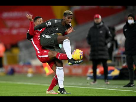 Liverpool's Georginio Wijnaldum (left)  vies for the ball with Manchester United's Paul Pogba.