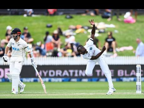 West Indies Kemar Roach bowls during play on day two of the first cricket test between the West Indies and New Zealand in Hamilton, New Zealand, Friday, December 4, 2020.