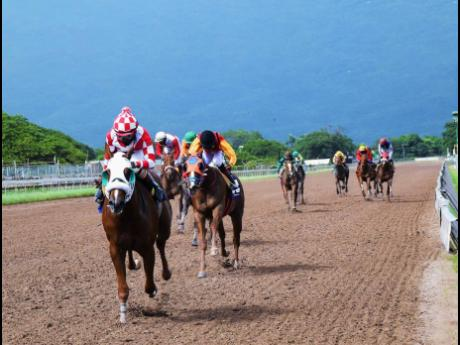 FURTHER AND BEYOND, ridden by Dane Nelson, wins the fourth race at Caymanas Park, Portmore, St Catherine, on Saturday, October 24, 2020.FURTHER AND BEYOND, ridden by Dane Nelson, wins the fourth race at Caymanas Park, Portmore, St Catherine, on Saturday, October 24, 2020.
