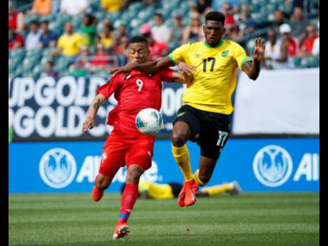 Jamaica's Damion Lowe (right) and Panama's Gabriel Torres battle for the ball during the first half of a Concacaf Gold Cup match in Philadelphia in 2019.