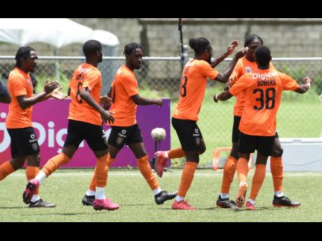 Ian Allen  Members of Tivoli Gardens' Jamaica Premier League team celebrate a goal against Vere United during a recent match at the UWI-JFF Captain Horace Burrell Centre of Excellence.