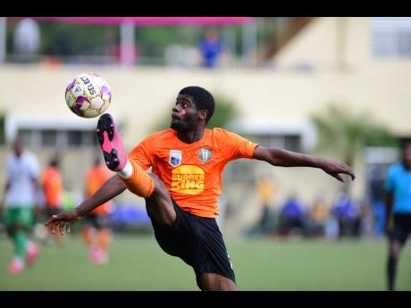 Goalscorer Horatio Morgan of Tivoli Gardens Football Club in action in the Jamaica Premier League quarter-final fixture against Vere United Football Club at the  UWI-JFF Captain Horace Burrell Centre of Excellence at UWI, Mona, in St Andrew yesterday. Tivoli thumped Vere 4-0.